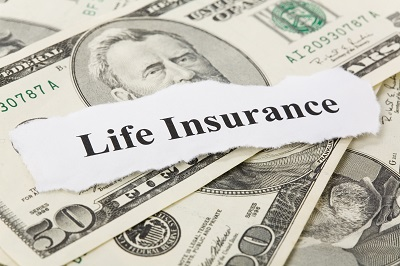 life insurance sign on stack of money